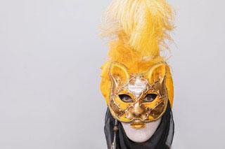 figure in carnival mask