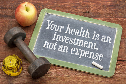 health is an investment on chalkboard