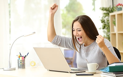 woman celebrating at desk